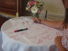 Bridal Shower Game - Place out a white apron and fabric markers, and have guests write a short note to the bride-to-be rather than having a guest book.
