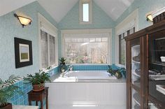 This master bath overlooks 4 private acres with a pond & stream in the peaceful distance...
