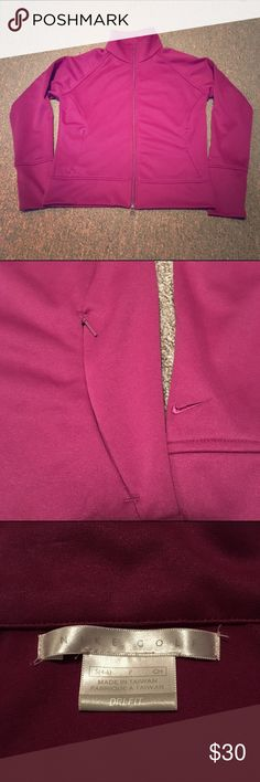 Nike Golf Dri Fit Jacket Excellent condition.  Side zip pockets.  Double zipper so it can be zipped up and then zipped from the bottom (see photo 4).  Darker purple/maroon color. Smoke free, pet free home. Nike Jackets & Coats