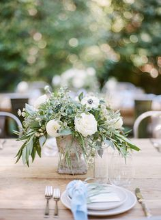 White & green florals in concrete container - FoundRentals blog