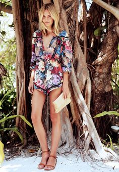A floral romper, easy sandals, and a clutch