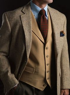 Moleskin waistcoat in camel with tapestry pocket square and sage and cream herringbone Harris tweed sportcoat at Ben Silver