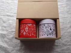 Red and white cans set of tea and baked goods - hug works online shop