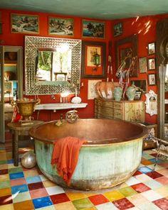 Gorgeous gypsy themed bathroom with copper bathtub