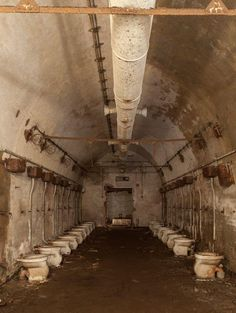 *Now Theirs a Lot of Shitters* Row of toilets in abandoned German bunker. Links to more photos of this bunker. Old Abandoned Buildings, Abandoned Property, Abandoned Asylums, Old Buildings, Abandoned Places, Abandoned Library, Abandoned Vehicles, Abandoned Hospital, Abandoned Castles