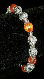 "Orange and silver accented bracelet. 8"" long. On ebay for sale! Starting bid $7"