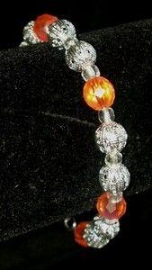 "Orange and silver accented bracelet. 8"" long. On ebay for sale! Starting bid $7"