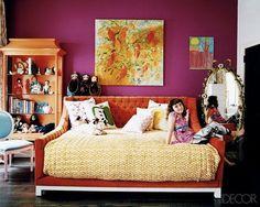 Don't you love the colors in this youthful but glamorous room...? by Jonathan Adler.