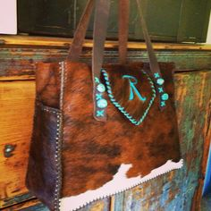A Buckaroo Diaper Tote with turquoise stones and monogram. gowestdesigns.us