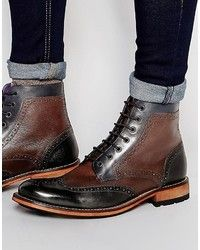 Grenson Brogue Detail Boots. Buy for $1,065 at farfetch.com.