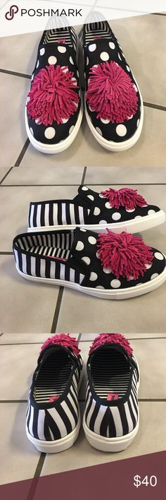 Betsey Johnson Slip-On Dahni Sneakers Sz 7 1/2 New without tags. Never worn. Black and white polka dot and stripe uppers with faux suede fuschia pom pom. Really unique and fun. Betsey Johnson Shoes Flats & Loafers