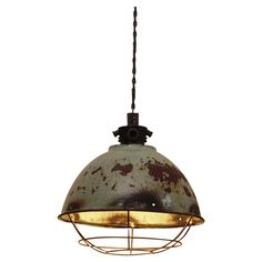 Add a touch of industrial elegance to your home with this statement metal pendant light. Team with white decor and matching accents to complete the look.