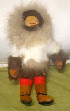 Vintage Inuit Eskimo Doll, with fur, leather, etc. Very collectible.  I believe this was made in Alaska The hand sewn face and body has amazing