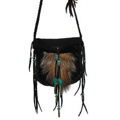 Badger tail medicine bag This bag is made with black deerskin leather It measures 6 1/2 x 6 3/4 over all It has 58 of narrow braided straps that tie and is decorated with a short stubby tail, glass and brass beads, brass cones, turquoise color disc beads, silver lined aqua pony beads and 2 turquoise magnesite nuggets This bag is handmade as are all of my bags and is ready to ship Wear this to your next mountain man rendezvous or pow wow Remember that not all colors appear the ...