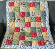 This is a fun quilt made of child friendly fabrics for either a boy or a girl. There are farm scenes, teddy bears, birdhouses and gender neutrals