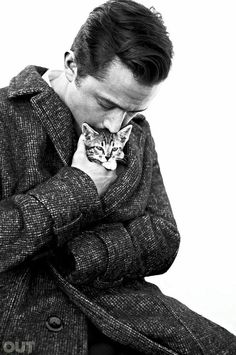 Joseph Gordon-Levitt cuddles up to a kitten    OUT magazine    October 2013