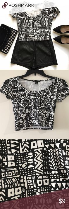 🎄BUY 2 GET 1 FREE🎄Tribal Print Crop Top This rad crop top features a white and black tribal print, short sleeves and scoop neck. 95% cotton, 5% spandex. NWOT, excellent condition. Forever 21 Tops Crop Tops