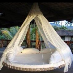 Old trampoline base used for a hanging swing bed.