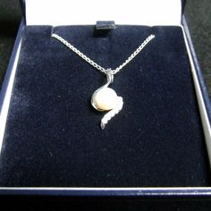 Classically elegant sterling silver pendant necklace with freshwater pearl and CZ.