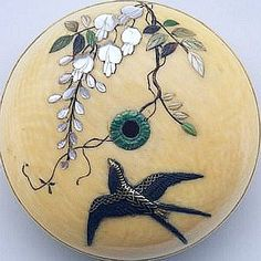 Metal Swallow on a 19th Century Japanese Ivory Button with inlaid MOP Blooms