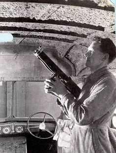 Spraying Limpet Asbestos in a bus - under construction; UK.