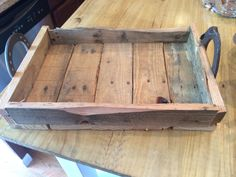 Tray made from pallet wood with horse shoe handles.
