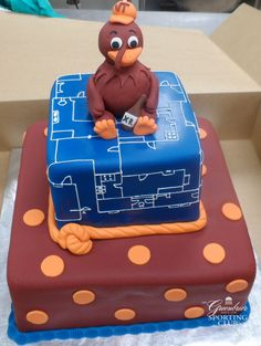 Virginia Tech orange and maroon themed cake with blueprint patterned tier and VT Hokie.