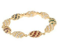"""Made to coordinate with Jackie's Berry Pin, the Royal Color Egg Bracelet was a gift to Jackie from Aristotle Onnasis for Easter of 1969. The presentation of this grand present, was simple and unpretentious. Laid across the breakfast tray with a simple note, no box, stating """"Happy Easter"""". The original cost was $49,000 in 1969 and contained flawless diamonds, rubies, amethysts, and sapphires. It was sold at the Sotheby's auction in 1996 for $126,750."""