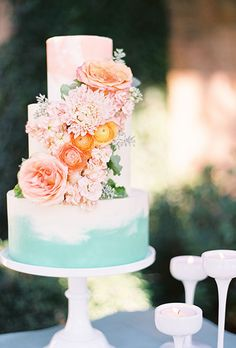 Three-Tiered Pink & Blue Cake with Flowers. Spring has finally sprung, which means it's time to start thinking of ways to incorporate the bright, flower-filled season into your wedding day. One of our favorite ways to add signs of spring to your big day is through your wedding cake. Sure, a classic white confection is always in-season, but we can't help but dream of romantic spring-inspired styles for nuptials from March to June.