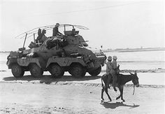 A Afrika Korps SdKfz 231 8 rad armored car operating near to Bengasi, Libyia during April of 1941
