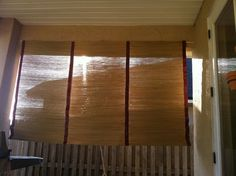 grass mats + colored duct tape = Diy porch Shade