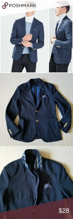 Zara Man Basic Collection casual blazer blue 44 Great used condition, no rips, stains or holes; navy blue casual blazer in a pique fabric; unlined with contrasting light blue color on the inside; sleeves are lined; sewn in handkerchief in the outside faux breast pocket; contrasting lining in the collar and elbow patches giving it a schoolboy blazer look; 2 inside breast pockets, 2 front pockets and 2 button closure; 100% polyester; length ca 29 inches, chest armpit t ca 21.5 inches. Zara…