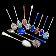 Sold For $475  Russian and Danish, late 19th century. An assembled group of enameled sterling silver spoons. Three demitasse spoons bear the mark in keeping with Ivan Ado, Kazan (1899-1908), the purity mark 84, and the Kokoshnik head. Four bear early marks (1885-1925) of David Anderson, Norway, including two demitasse spoons, one cobalt enameled teaspoon, and one ornately patterend teaspoon, PLUS two enameled sterling demitasse spoons marked 930 S M, and two enameled teaspoons by B. Hertz…
