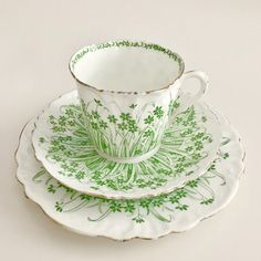 This is a Wileman Foley shape cup, saucer and side plate printed with the Grass pattern in a beautifully bright green colour. Wileman (later renamed Shelley and sometimes called Foley) was one of the most respected manufacturers of fine bone china tea sets in the late 19th Century, and many of their products are now collectors items. They made many different shapes of cups and the Foley shape is one of the turn of the century, at the heart of the Art Nouveau movement. Its elegantly…