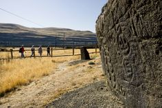 A tour group sets out on the pictograph trail near Horsethief Lake on the Washington side of the Columbia Gorge. In the foreground is one of the petroglyphs that was relocated when The Dalles Dam was built. Darryl James / special to The Oregonian