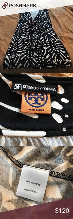 Tory Burch wrap around dress size Lg Gorgeous wrap around dress or can be used as a swim cover up. Ties in the front. Recently purchased just not for me. Dress has never been worn no tags. Price is firm Tory Burch Dresses