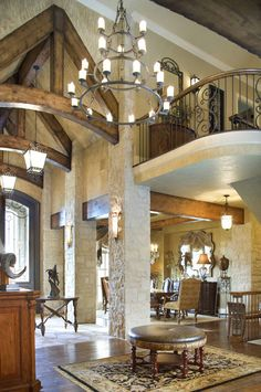 Open foyer with stone and beams.