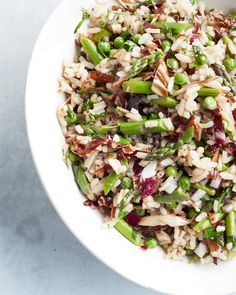 chilled rice salad flecked with fresh asparagus and peas.- Consider this a classy Italian take on rice salad. Anchovies, garlic, and basil season a mix of Arborio rice, peas, and asparagus. Healthy Rice Recipes, Rice Salad Recipes, Pea Recipes, Dinner Recipes, Healthy Dishes, Dinner Menu, Best Asparagus Recipe, Asparagus Salad, Fresh Asparagus