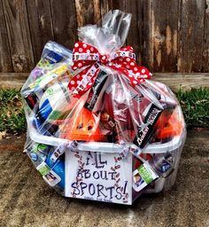 My brilliant idea for the year. Use a clear shower curtain liner to wrap big fundraiser baskets!!