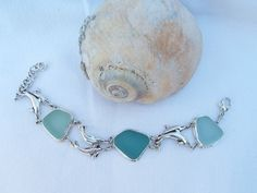Sterling Silver Vintage Dolphin & Genuine by SunshinedayDesigns #seaglass #dolphin #bracelet #hawaiian #ooak #teal #blue #seafoam #vintage #upcycle