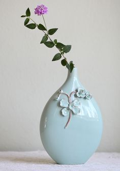 "Mystic Water Flower Vase 29.99 at shopruche.com. A simple antique-like flower adorns this mint colored vase that has a narrow opening and a wide body.  Approx. 10""L x 7""W"