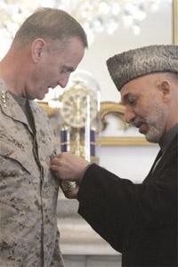 Afghan President Hamid Karzai awards the Afghanistan honour medal of King Amanullah Khan to NATO`s Supreme Allied Commander Europe General James Jones in Kabul