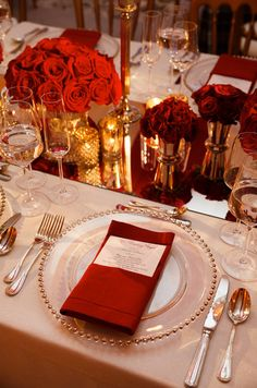 Guest tables featured different chargers and napkins to add more variety to the decor. Check out the full wedding gallery: http://www.colincowieweddings.com/the-galleries/weddings-by-colin-cowie/regal-red-gold-wedding