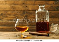 a glass with cognac or brandy on rustic background  www.deniorigacciphotographer.ro