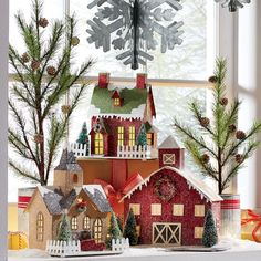 "Handcrafted paperboard buildings with a heavy glitter finish and sisal trees. LED light inside. Each uses 3 AAA batteries (not included). Holiday House: 8"" w x 8 1/2"" h x 6"" d. Holiday Church: 7 1/2"" w x 10 1/4"" h x 6 1/4"" d. Holiday Barn: 11 3/4"" w x 10 1/2"" h x 7 3/4"" d."