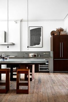 Art in the kitchen:  bold and black, looking a bit like an upside down Rosetta Stone.  It works well in this streamlined kitchen.