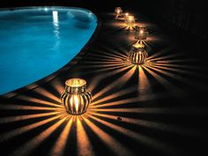 The idea-Upcycled coffee can luminaries:  Pool side.