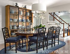 Dining chairs with a Chinese fret design on the backs surround a large Napoleon III dining table. - Photo: Eric Roth / Design: George Nunno and Jon Maroto