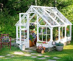 This greenhouse is made from the windows of an old dairy farm. Virtually all the materials are recycled, save for the galvanized screws that hold it all together. It provides the perfect greenhouse for budding annuals.