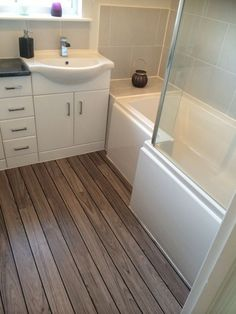 Bathroom ideas: This white bathroom furniture looks great alongside the wooden laminate flooring by Fiona from Annan White Bathroom Furniture, Bathroom Interior, Bathroom Remodeling, Remodeling Ideas, Bathroom Storage, Bedroom Furniture, Diy Furniture, Bathroom Shelves, Bathroom Cabinets